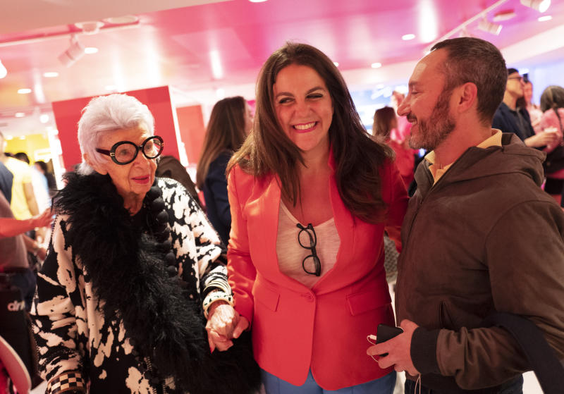 Rachel Shechtman, center, founder of Story, leads model Iris Apfel through her store on its opening day at Macy's, Wednesday, April 10, 2019, in New York. Macy's bought Story a year ago and Shechtman came on board as its brand experience officer. (AP Photo/Mark Lennihan)