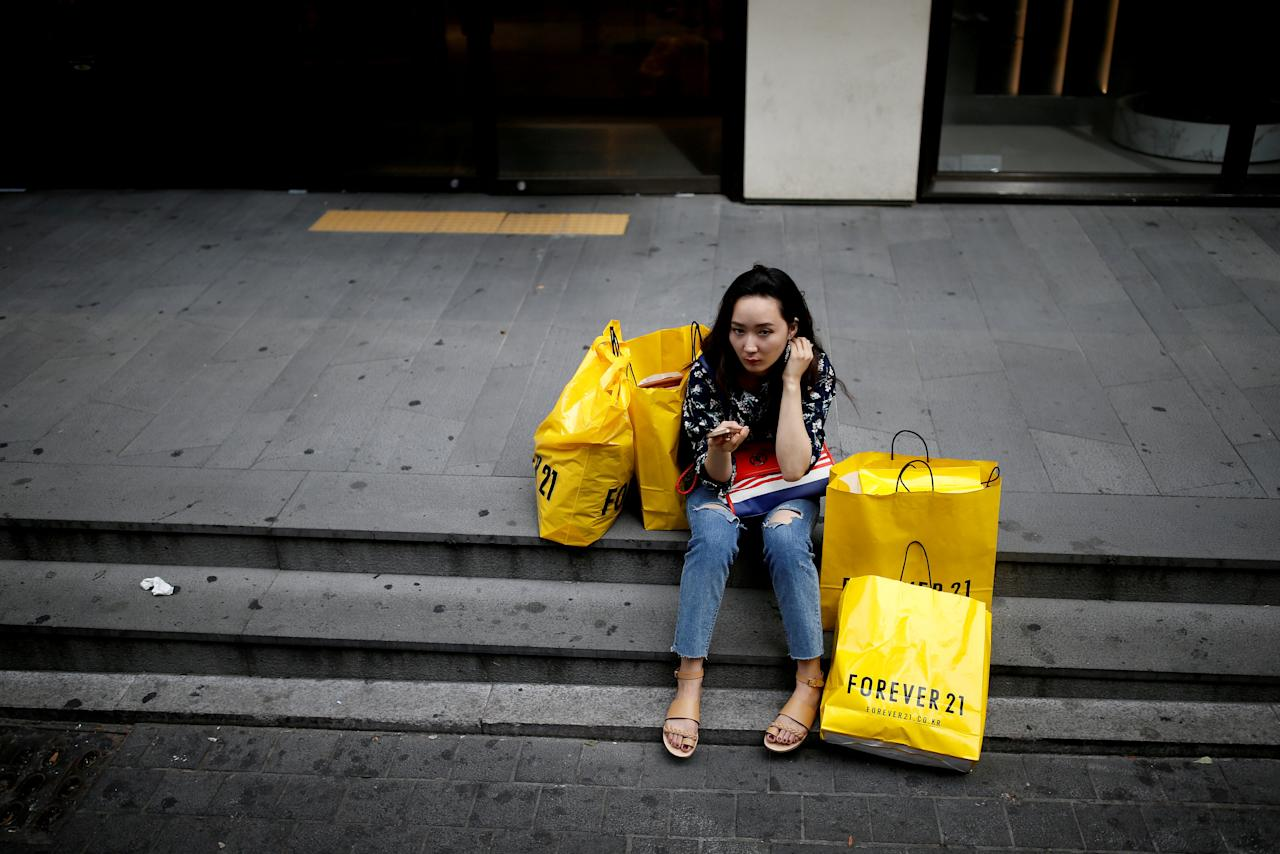 FILE PHOTO: A woman uses her mobile phone at Myeongdong shopping district in Seoul, South Korea, August 29, 2016.    REUTERS/Kim Hong-Ji/File Photo