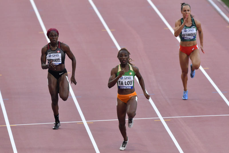 Crystal Emmanuel, of Canada, Marie-Josée Ta Lou, of The Ivory Coast, and Inna Eftimova, of Bulgaria, from left, compete in a women's 100 meter race heat during the World Athletics Championships in Doha, Qatar, Saturday, Sept. 28, 2019. (AP Photo/Martin Meissner)