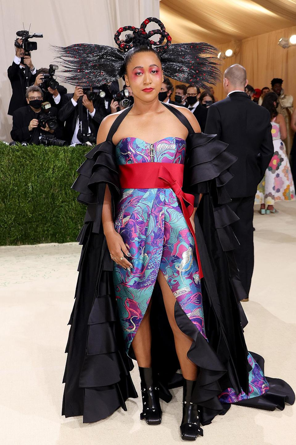 <p>Osaka co-hosted this year's Gala, opting for a Louis Vuitton dress as she walked the carpet with boyfriend Cordae.</p>