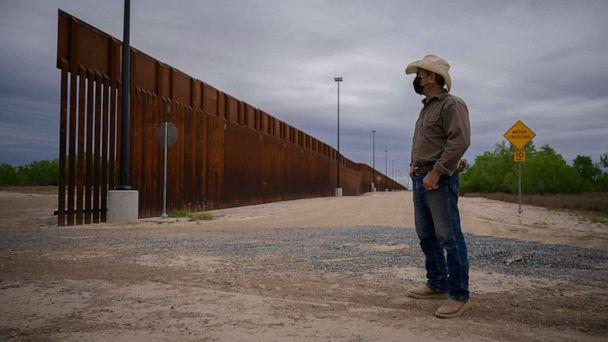 PHOTO: In a photo taken on March 28, 2021, ranch owner Tony Sandoval stands before a portion of the unfinished border wall that former President Donald Trump tried to build, near the southern Texas border city of Roma. (Ed Jones/AFP via Getty Images, FILE)