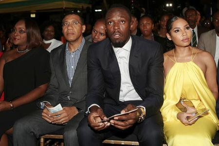 Jamaica's Prime Minister Andrew Holness (2nd L), his wife and Member of Parliament Juliet Holness (L), Olympic Champion Usain Bolt (2nd R) and his girlfriend Kasi Bennett attend a ceremony for the unveiling of Bolt's statue, at the Statue Park at the National Stadium, in Kingston, Jamaica December 3, 2017. REUTERS/Gilbert Bellamy