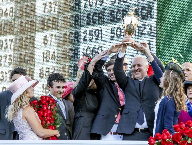Todd Pletcher hold up the winner's trophy after Always Dreaming #5 won the Kentucky Derby on Saturday. (Getty)