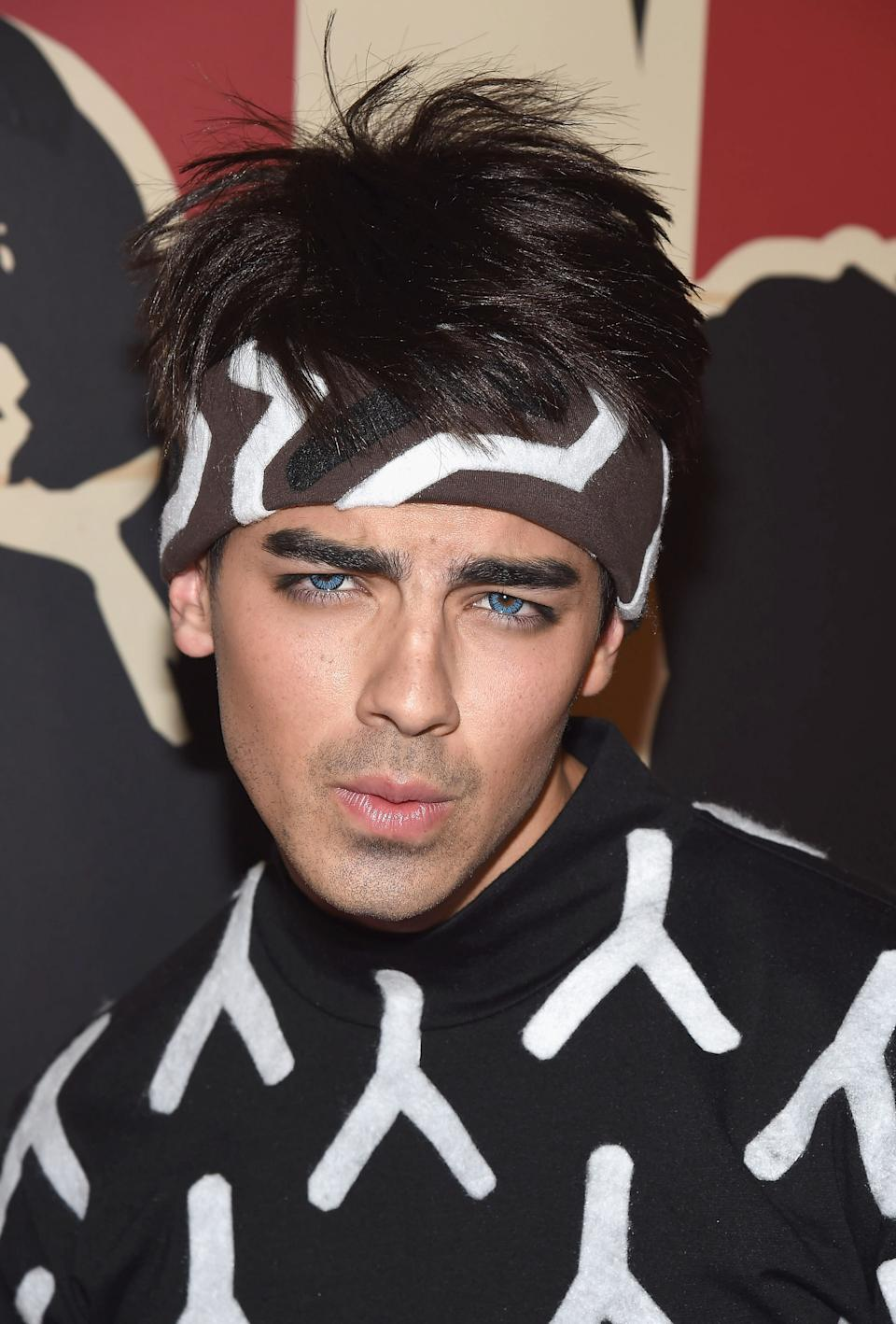 """<strong>Joe Jonas as Derek Zoolander</strong><br><br>At Heidi Klum's 2014 Halloween party, Joe Jonas arrived as Derek Zoolander. And yes — he wore colored contacts. How else is a guy supposed to show off his Blue Steel?<span class=""""copyright""""><a href=""""http://www.gettyimages.com/search/photographer?family=editorial&photographer=Gary+Gershoff"""" rel=""""nofollow noopener"""" target=""""_blank"""" data-ylk=""""slk:Gary Gershoff"""" class=""""link rapid-noclick-resp"""">Gary Gershoff</a> / Contributor</span>"""