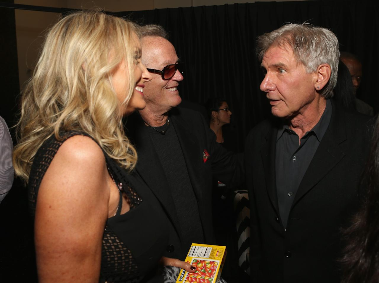 HOLLYWOOD, CA - APRIL 24:  (L-R) Parky Fonda and actors Peter Fonda and Harrison Ford attend Target Presents AFI's Night at the Movies at ArcLight Cinemas on April 24, 2013 in Hollywood, California.  (Photo by Jesse Grant/Getty Images for AFI)