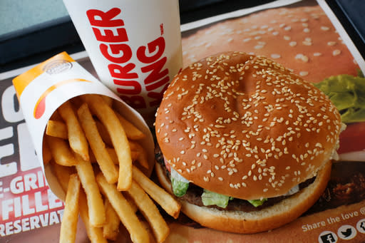 FILE- This Feb. 1, 2018, file photo shows a Burger King Whopper meal combo at a restaurant in the United States. Burger King says its sorry for offering a lifetime supply of Whoppers to Russian women who get pregnant from World Cup players. (AP Photo/Gene J. Puskar, File)