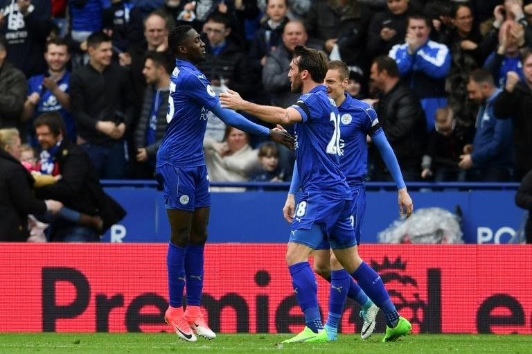 Leicester City's Wilfred Ndidi (L) celebrates scoring their opening goal against Stoke City at King Power Stadium in Leicester, central England on April 1, 2017