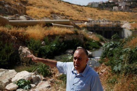 Shony Goldberger, director of the Jerusalem district in Israel's Environmental Protection Ministry speaks during an interview with Reuters as sewage flows in the Kidron Valley, on the outskirts of Jerusalem July 6, 2017. Picture taken July 6, 2017. REUTERS/Ronen Zvulun