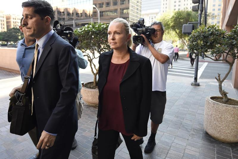 Margaret Hunter, center, the wife of Rep. Duncan Hunter, arrives for an arraignment hearing in San Diego on Thursday, Aug. 23, 2018.