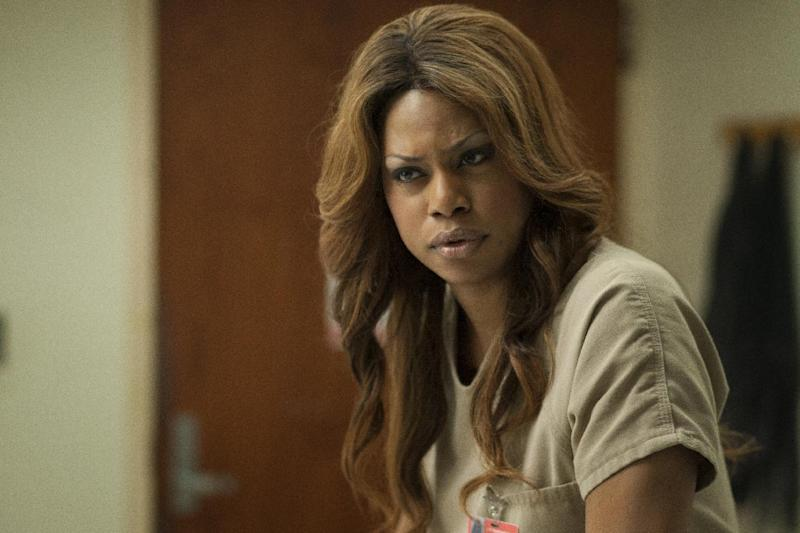 """This image released by Netflix shows Laverne Cox in a scene from """"Orange is the New Black."""" The Netflix show set in a women's prison was named outstanding comedy series at the 25th annual GLAAD Media Awards' New York ceremony. Cast members, including Cox, who won her own GLAAD honor at the organization's Los Angeles awards ceremony last month, accepted the award Saturday, May 3, 2014, at the Waldorf Astoria hotel. (AP Photo/Netflix, Eric Leibowitz, file)"""