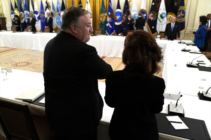Secretary of State Mike Pompeo talks with CIA director Gina Haspel before President Donald Trump arrives for a Cabinet Meeting in the East Room of the White House, Tuesday, May 19, 2020, in Washington. (AP Photo/Evan Vucci)