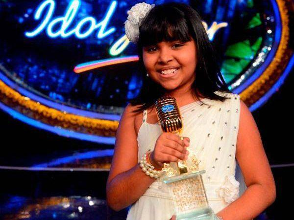<p><strong>Anjana Padmanabhan:</strong> This Bangalore girl is the first winner of Indian Idol Junior. Surprisingly she knows no Hindi, but sings like a pro. This cute little kid, all of 10 years, has enthralled viewers across the country with her melodious voice and charm. Not only has she impressed judges Vishal - Shekhar and Shreya Ghoshal, but has also managed to become the audience's favourite with her versatile and consistent performances.</p>