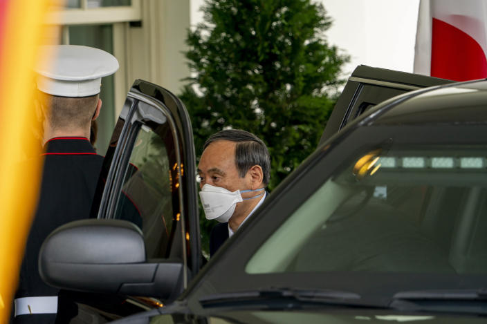 Japanese Prime Minister Yoshihide Suga arrives at the West Wing of the White House in Washington, Friday, April 16, 2021. (AP Photo/Andrew Harnik)