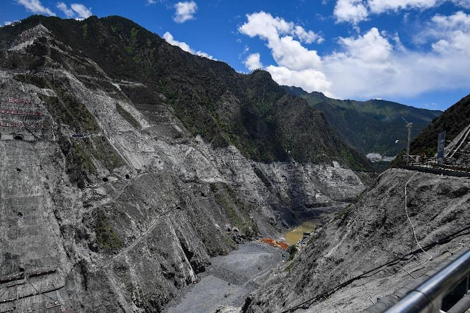Beijing is building hydropower at a breakneck pace in ethnically Tibetan regions as part of an ambitious undertaking to reduce the country's dependence on coal and cut emissions that have made it the world's top polluter. (AFP Photo/Johannes EISELE)