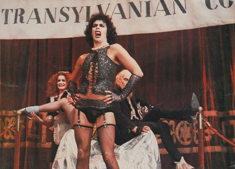 "Tim Curry, backed by Patricia Quinn and Richard O'Brien, in ""The Rocky Horror Picture Show."" (Photo: Movie Poster Image Art via Getty Images)"