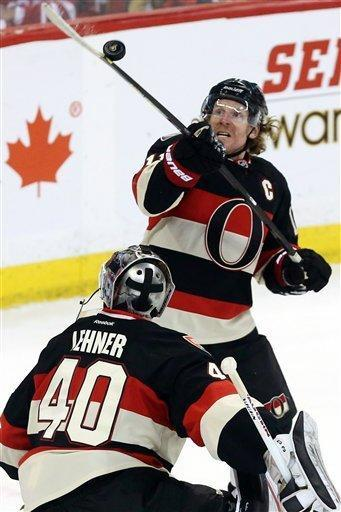 Ottawa Senators winger Daniel Alfredsson knocks the puck out of the air as goaltender Robin Lehner watches during the second period of their NHL hockey game against the Tampa Bay Lightning in Ottawa, Ontario, Saturday, March 23, 2013. (AP Photo/The Canadian Press, Fred Chartrand)