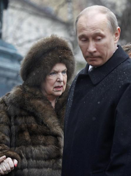 "FILE - In this file photo taken on Thursday, March 29, 2012, Russian Prime Minister Vladimir Putin, right, and Galina Vishnevskaya, widow of Mstislav Rostropovich, stand during a ceremony of opening of the monument to a well-known Soviet and Russian cellist and conductor Mstislav Rostropovich in Moscow, Russia. Russian opera legend Galina Vishnevskaya died on December 11, at the age of 86. ""She is dead, it's true,"" a spokesperson at the Vishnevskaya Opera Center told reporters Tuesday. (AP Photo/ Mikhail Metzel, Pool, File)"