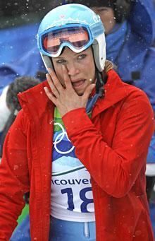 Julia Mancuso reacts as she leaves the finish area after finishing her first run of the giant slalom