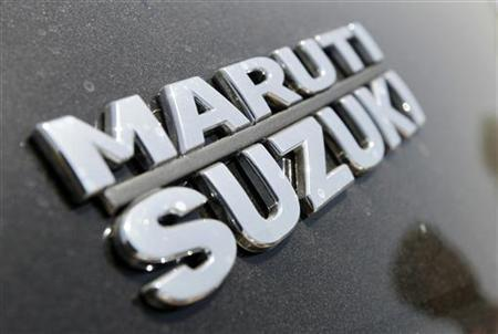 The brand name of Maruti Suzuki is pictured on a Swift car at the company's stock yard in Ahmedabad