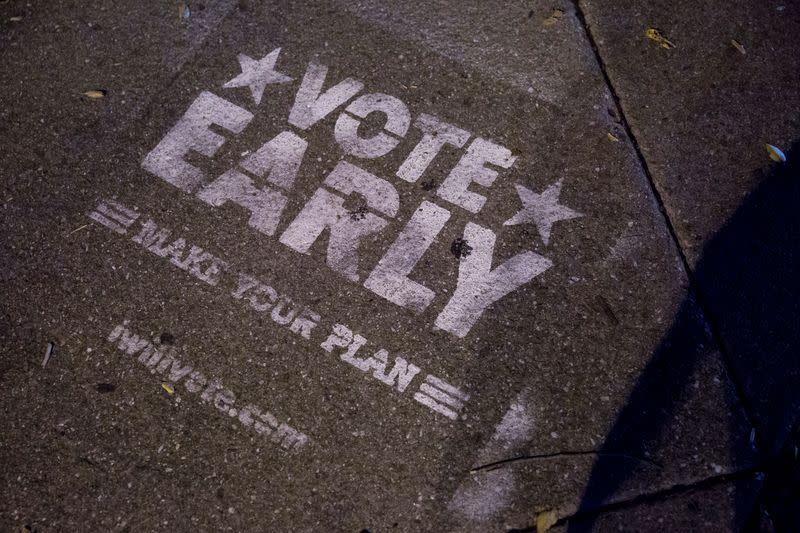 """A reminder to """"vote early"""" is seen outside of The Philadelphia High School for Creative and Performing Arts, an early voting location for the upcoming presidential election, in Philadelphia, Pennsylvania"""