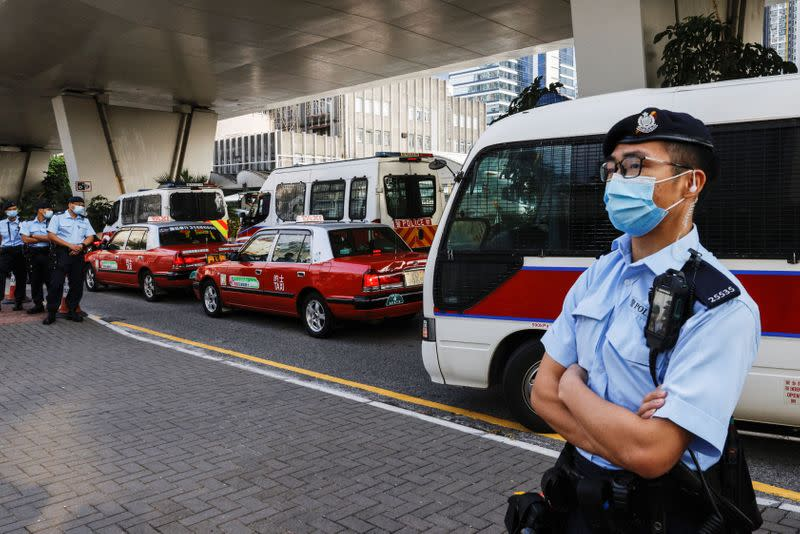 A police arrives West Kowloon Magistrates' Courts by police van with pro-democracy activist, in Hong Kong