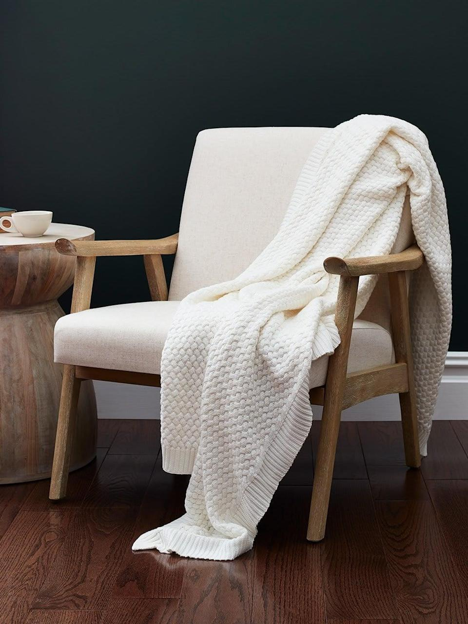 <p>Made from organic cotton, the <span>Boll & Branch Chunky Knit Throw Blanket</span> ($125) is as soft as ever and will be a welcomed addition to anyone's living room. </p>