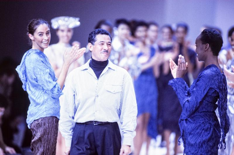 Issey Miyake with models at his spring 1992 runway presentation in France.  (Photo: Pool ARNAL/GARCIA via Getty Images)
