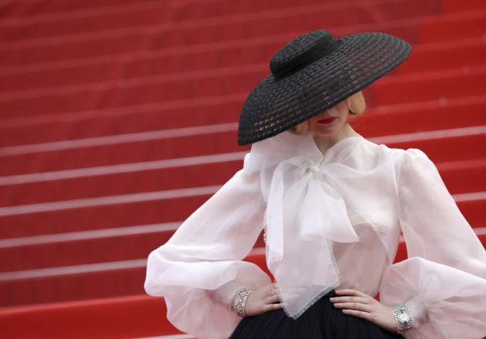 """Jury member Elle Fanning poses for photographers at the premiere of the film """"Once Upon a Time in Hollywood"""" at the 72nd international film festival, Cannes, southern France, on May 21, 2019. (Photo by Vianney Le Caer/Invision/AP)"""