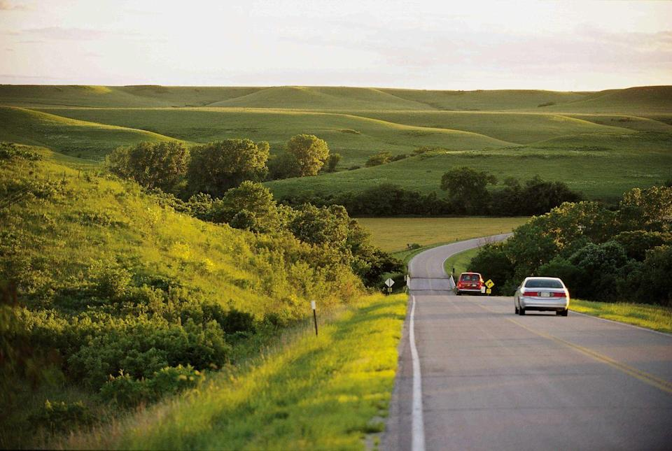 """<p><strong>The Drive: </strong><a href=""""https://www.travelks.com/ksbyways/flint-hills/"""" rel=""""nofollow noopener"""" target=""""_blank"""" data-ylk=""""slk:Flint Hills National Scenic Byway"""" class=""""link rapid-noclick-resp"""">Flint Hills National Scenic Byway</a></p><p><strong>The Scene: </strong>Enjoy nature by rolling your windows down and taking in incredible panoramic vistas of rolling hills and pretty prairie flowers on this scenic byway. (Psst: It's best to drive through this 47.2-mile route in the spring!)</p><p><strong>The Pit-Stop: </strong>Relax at <a href=""""https://www.travelks.com/listing/schrumpf-hill-scenic-overlook/12131/"""" rel=""""nofollow noopener"""" target=""""_blank"""" data-ylk=""""slk:Schrumpf Hill Scenic Overlook"""" class=""""link rapid-noclick-resp"""">Schrumpf Hill Scenic Overlook</a> right before dusk. After all, the Flint Hills are famous for being one of the <a href=""""http://green-landscape.com/worlds-top-7-places-to-watch-sunsets/"""" rel=""""nofollow noopener"""" target=""""_blank"""" data-ylk=""""slk:best places in the world to see the sun set"""" class=""""link rapid-noclick-resp"""">best places in the world to see the sun set</a>.  </p>"""