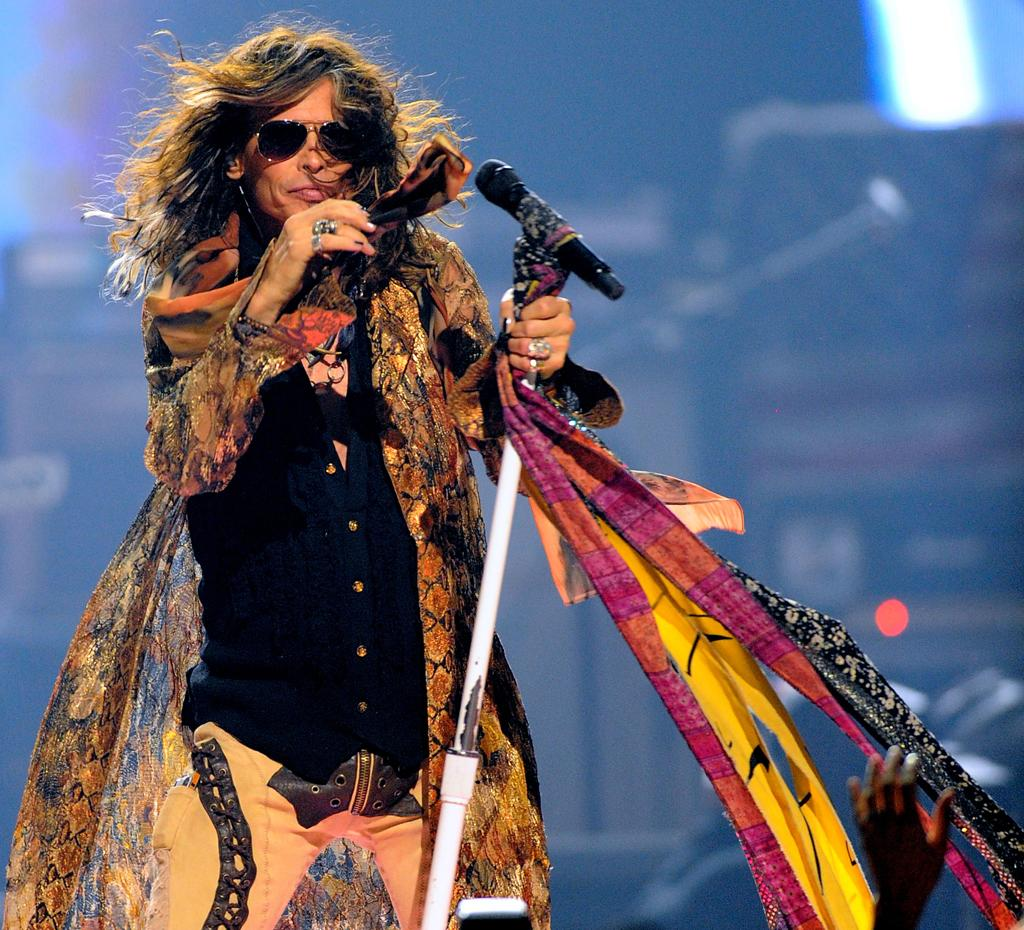 Singer Steven Tyler of Aerosmith performs onstage during the 2012 iHeartRadio Music Festival at the MGM Grand Garden Arena on September 22, 2012 in Las Vegas, Nevada.  (Photo by Isaac Brekken/Getty Images for Clear Channel)
