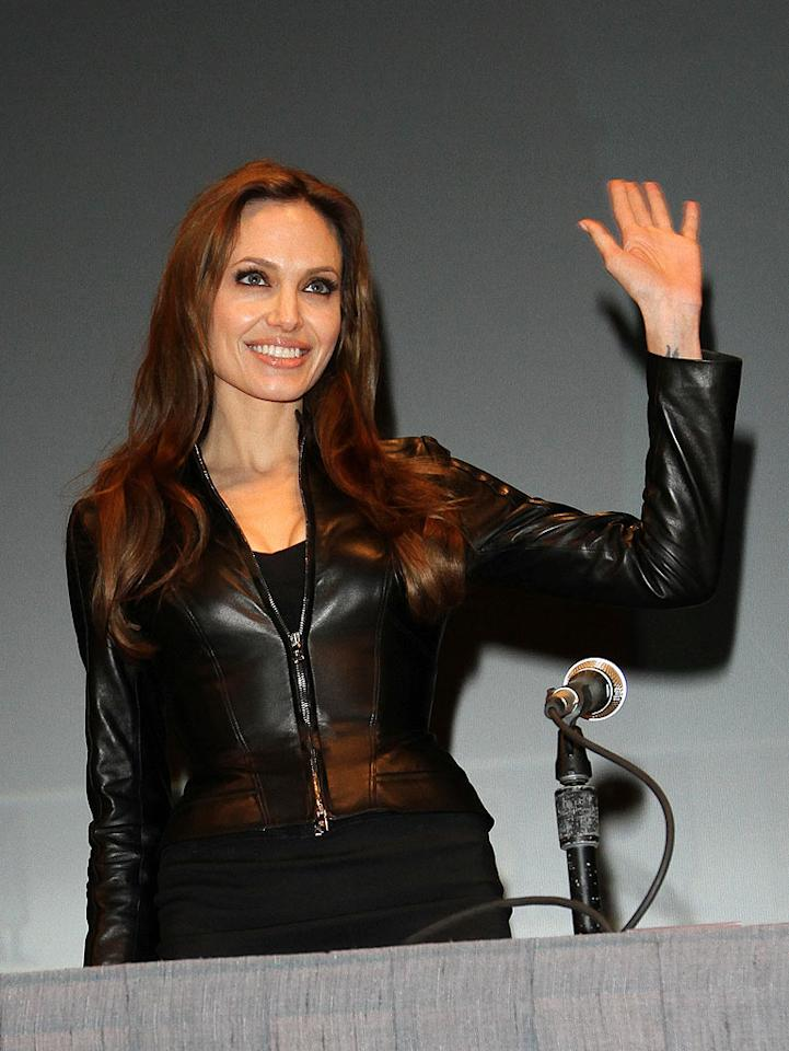 "The <i>National Enquirer</i> reports Angelina Jolie is getting a ""$20-million payday for her tell-all memoir,"" which will ""devastate her love rival Jennifer Aniston!"" The memoir also promises to delve into Jolie's ""experimenting with lesbianism, her struggle with mental illness, and how she won Brad Pitt."" For the biggest shocker, though, see what her rep told <a href=""http://www.gossipcop.com/angelina-jolie-memoir-writing-20-million-autobiography-written/"" target=""new"">Gossip Cop</a>. Richie Buxo/<a href=""http://www.splashnewsonline.com"" target=""new"">Splash News</a> - July 22, 2010"
