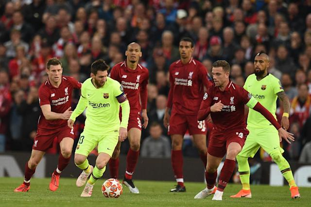 Barcelona's Argentinian striker Lionel Messi (L) is marked by Liverpool's English midfielder Jordan Henderson (R) during the UEFA Champions league semi-final second leg football match between Liverpool and Barcelona at Anfield in Liverpool, north west England on May 7, 2019. (Photo by Oli Scarff/AFP/Getty Images)