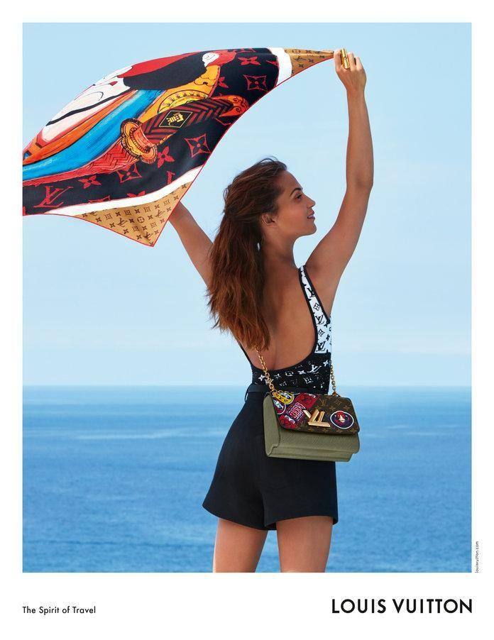She's seen posing in black mini-shorts holding a silk scarf. Source: Louis Vuitton
