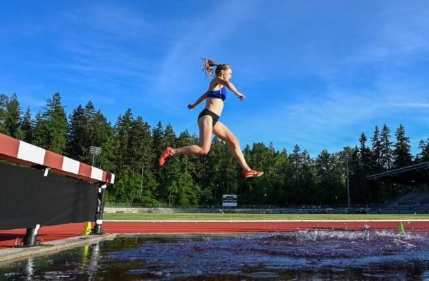 Julia Howley, who grew up in St. John's, soars over a hurdle at the Vancouver Sun Harry Jerome Track Classic on June 12. (@Everything.You.Got/Instagram - image credit)