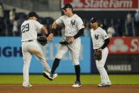 New York Yankees' Gleyber Torres, right, Aaron Judge, center, and Gio Urshela celebrate after a baseball game against the Texas Rangers, Monday, Sept. 20, 2021, in New York. (AP Photo/Frank Franklin II)