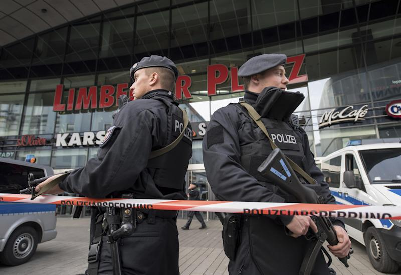 Police guard in front of a shopping mall in Essen, Germany, Saturday, March 11, 2017. Police have ordered the shopping mall in the western German city of Essen not to open after receiving credible tips of an imminent attack. The shopping center and the adjacent parking lot stayed closed Saturday morning as over a hundred police officers searched the compound. (Bernd Thissen/dpa via AP)