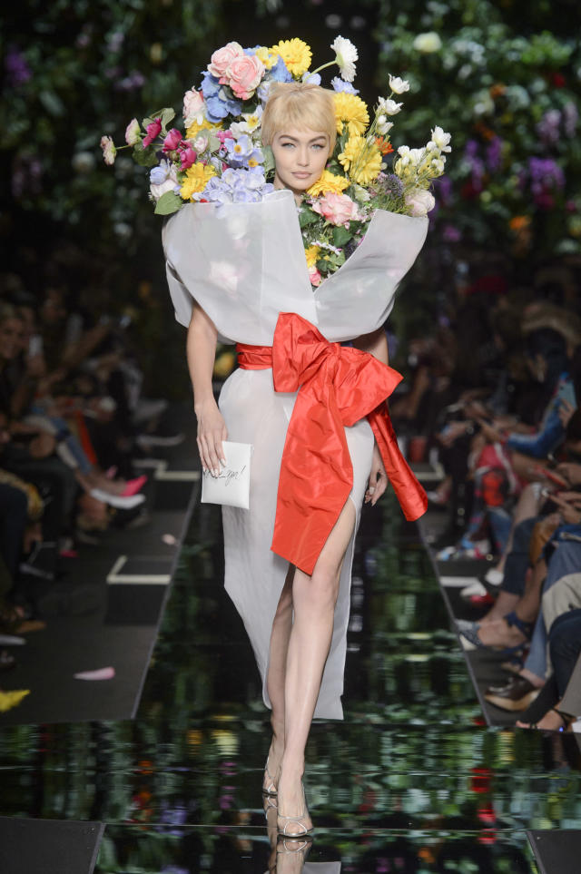 <p><i>Gigi Hadid channeling a bouquet of flowers at the SS18 Moschino show. (Photo: ImaxTree) </i></p>