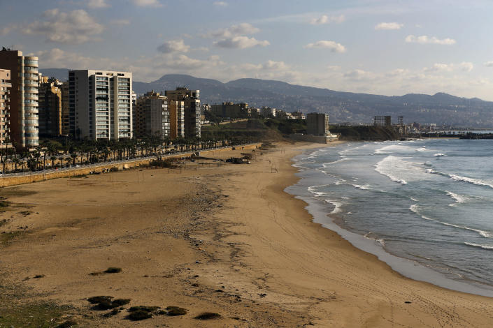 The Ramlet al-Baida public beach is empty during a lockdown aimed at curbing the spread of the coronavirus, in Beirut Lebanon, Thursday, Jan. 21, 2021. Authorities on Thursday extended a nationwide lockdown by a week to Feb. 8 amid a steep rise in coronavirus deaths and infections that has overwhelmed the health care system. (AP Photo/Bilal Hussein)