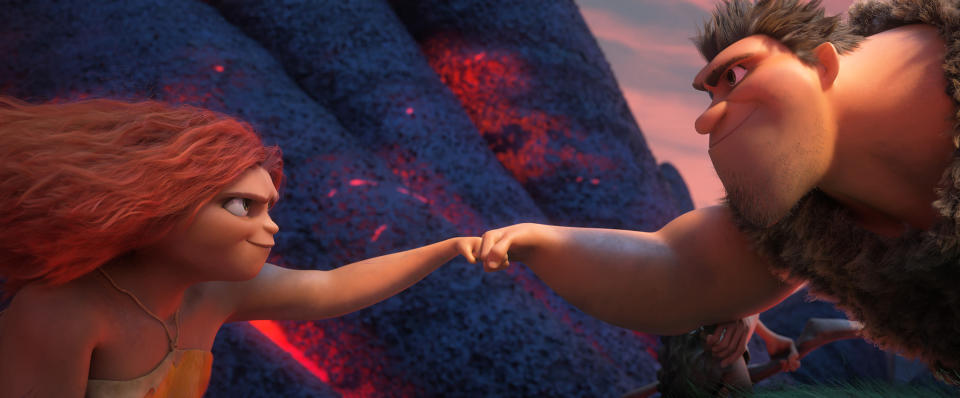 "This image released by DreamWorks shows Eep Crood, voiced by Emma Stone, left, and Grug Crood, voiced by Nicolas Cage, in a scene from the animated film ""The Croods: A New Age."" (DreamWorks Animation via AP)"