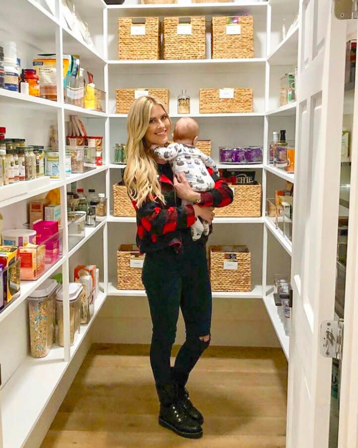 """<strong>Keep Dry Goods Fresher Longer </strong> In HGTV star Christina Anstead's pantry, Kate Pawlowski of <a href=""""https://doneanddonehome.com/"""" rel=""""nofollow noopener"""" target=""""_blank"""" data-ylk=""""slk:Done & Done Home"""" class=""""link rapid-noclick-resp"""">Done & Done Home</a> decanted foods like pasta and cereal into clear, airtight containers. """"They stay fresher, you can see how much is left, and it's more visually appealing,"""" she says. Pawlowski also suggests arranging shelves in a way that makes sense for your family. Because Anstead has young kids, the organizer arranged to have healthy snacks at the kids' height level, and junk food out of their reach. """"You also want to put heavier items like bulk drinks lower down so you don't have to lift too far when you're putting them away from the grocery store,"""" she adds. Anstead is thrilled with the results: """"I feel happy when I look in here now!"""""""