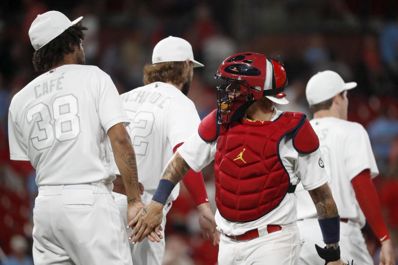 St. Louis Cardinals' Yadier Molina, right, and Jose Martinez celebrate the Cardinals' 8-3 victory over the Colorado Rockies in a baseball game Friday, Aug. 23, 2019, in St. Louis. (AP Photo/Jeff Roberson)