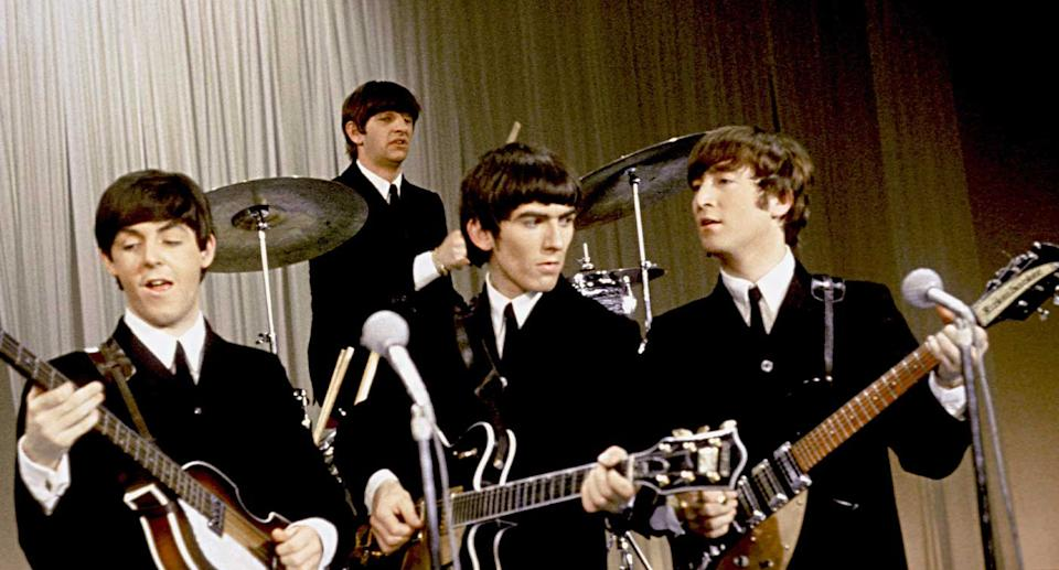 The Beatles perform onstage in a still from their movie A Hard Day's Night.