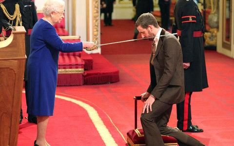 Wiggins is knighted by the Queen - Credit: PA