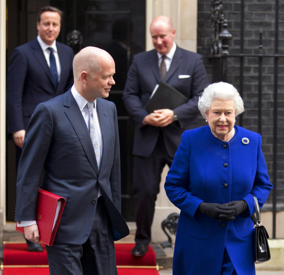LONDON, UNITED KINGDOM - DECEMBER 18: (EMBARGOED FOR PUBLICATION IN UK NEWSPAPERS UNTIL 48 HOURS AFTER CREATE DATE AND TIME) British Foreign Secretary William Hague and Queen Elizabeth II leave Number 10 Downing Street (followed by British Prime Minister David Cameron and Queen Elizabeth II's Private Secretary Sir Christopher Geidt) after attending the Government's weekly Cabinet meeting on December 18, 2012 in London, England.  The Queen's visit to the weekly Cabinet meeting as an observer is the first time a Monarch has attended the meeting since Queen Victoria's reign. (Photo by Indigo/Getty Images)