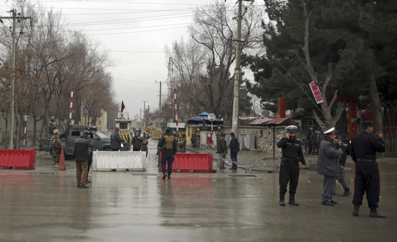 Security forces inspect the site of a suicide bombing in the diplomatic area of capital Kabul, Afghanistan, Saturday, Feb. 24, 2018. Interior ministry spokesman Najib Danish said several people were wounded in Saturday's attack in the Shash Darak area of Kabul, near NATO headquarters and not far from the U.S. Embassy. (AP Photo/Massoud Hossaini)