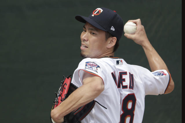 Minnesota Twins starting pitcher Kenta Maeda warms up before pitching a spring training baseball game against the Boston Red Sox Monday, Feb. 24, 2020, in Fort Myers, Fla. (AP Photo/John Bazemore)