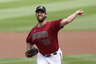 Arizona Diamondbacks starting pitcher Madison Bumgarner (40) throws during the first inning of a spring training baseball game against the Oakland Athletics Tuesday, March 16, 2021, in Scottdale, Ariz. (AP Photo/Ashley Landis)