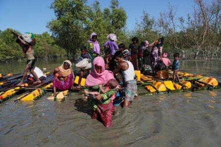 Rohingya refugees come out of an improvised raft after crossing the Naf River at Sabrang near Teknaf, Bangladesh November 10, 2017. REUTERS/Mohammad Ponir Hossain