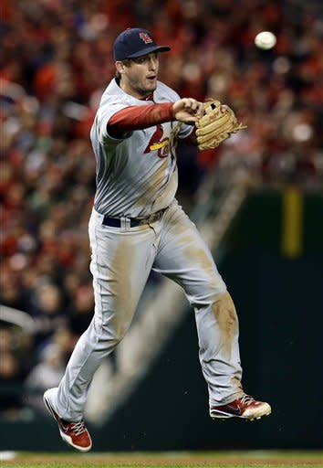 St. Louis Cardinals third baseman David Freese throws out Washington Nationals' Michael Morse in the sixth inning of Game 5 of the National League division baseball series on Friday, Oct. 12, 2012, in Washington. (AP Photo/Alex Brandon)