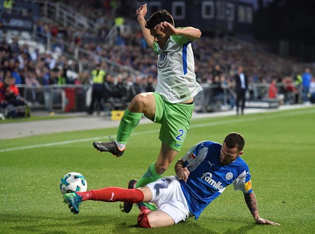 Soccer Football - Bundesliga Promotion/Relegation Playoff Second Leg - Holstein Kiel vs VfL Wolfsburg - Holstein-Stadion, Kiel, Germany - May 21, 2018 Wolfsburg's Josip Brekalo in action with Holstein Kiel's Dominik Schmidt REUTERS/Fabian Bimmer DFL RULES TO LIMIT THE ONLINE USAGE DURING MATCH TIME TO 15 PICTURES PER GAME. IMAGE SEQUENCES TO SIMULATE VIDEO IS NOT ALLOWED AT ANY TIME. FOR FURTHER QUERIES PLEASE CONTACT DFL DIRECTLY AT + 49 69 650050